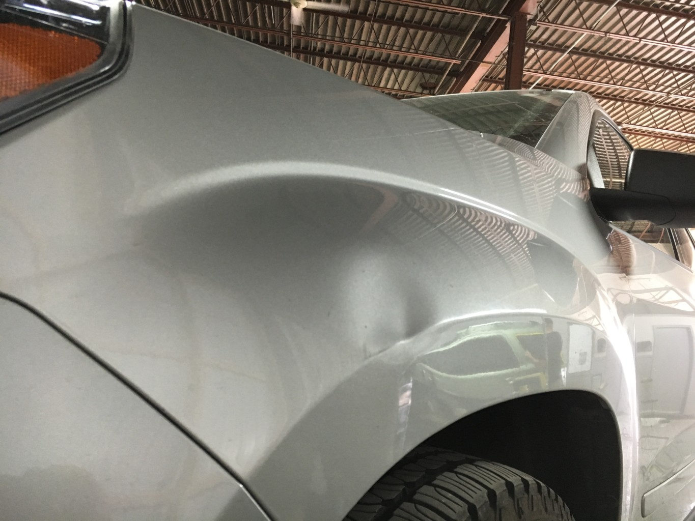 Paintless Dent Repair Grand Rapids, Michigan: Acadia fender - before