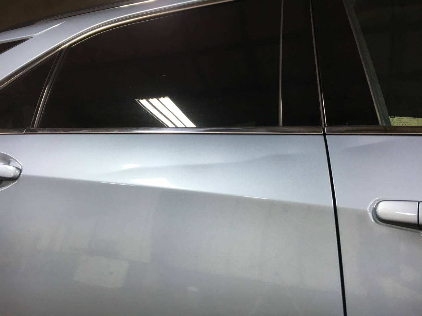 Paintless Dent Repair Grand Rapids, Michigan: Equinox door - before