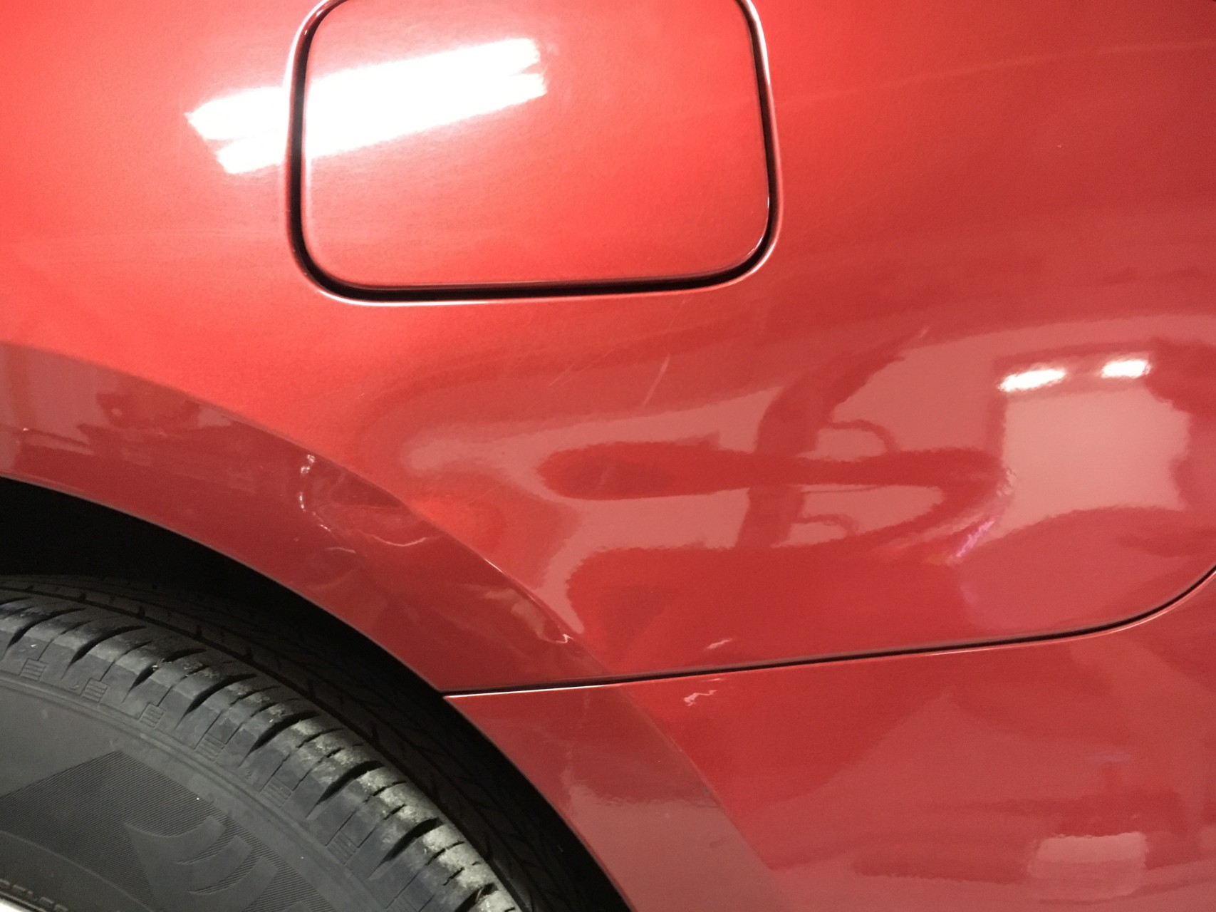 Paintless Dent Repair Grand Rapids, Michigan: Car quarter panel - before